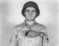 Paratrooper with pigeon in harness World War 2